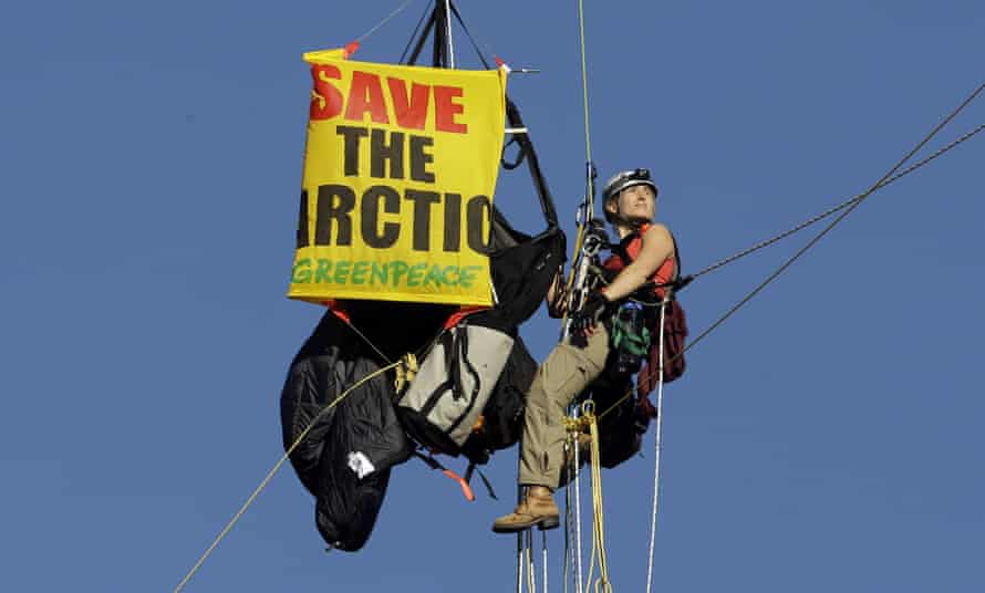 An activist is seen suspended from the St Johns bridge as part of a protest to block the Royal Dutch Shell PLC icebreaker Fennica from leaving for Alaska on 30 July 2015.