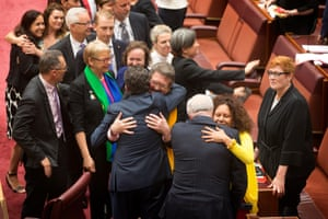 The yes vote side celebrate their win on the historic bill to amend the marriage act in the senate chamber of Parliament House, Canberra this afternoon.
