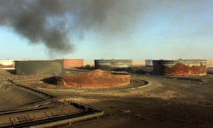 Smoke billows from a petroleum storage tank at the al-Sidra oil terminal on Libya's northern coast