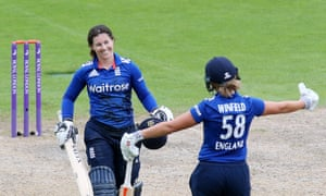 Tammy Beaumont, left, celebrates scoring her first international century for England celebrates Lauren Winfield who also made a ton during the second one-day international against Pakistan.