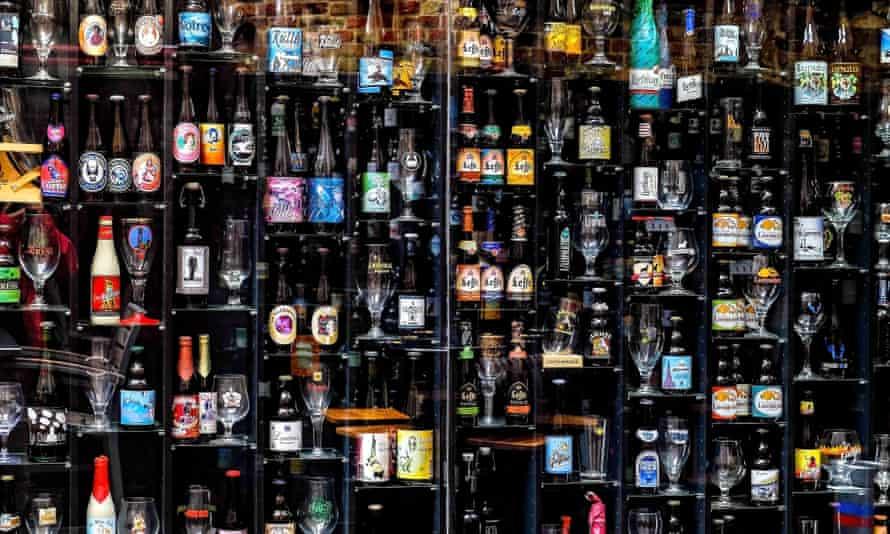 Range of Belgian beers displayed in a cabinet.