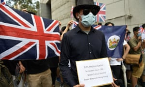 An activist holds a petition letter addressed to the consul general as pro-democracy demonstrators gather outside the British consulate-general building