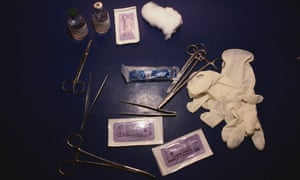 Forceps, rubber gloves and other items used in female genital mutilation