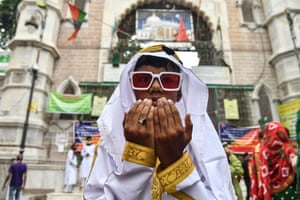 Ajmer, India. A young Muslim devotee offers prayers during the Eid al-Adha