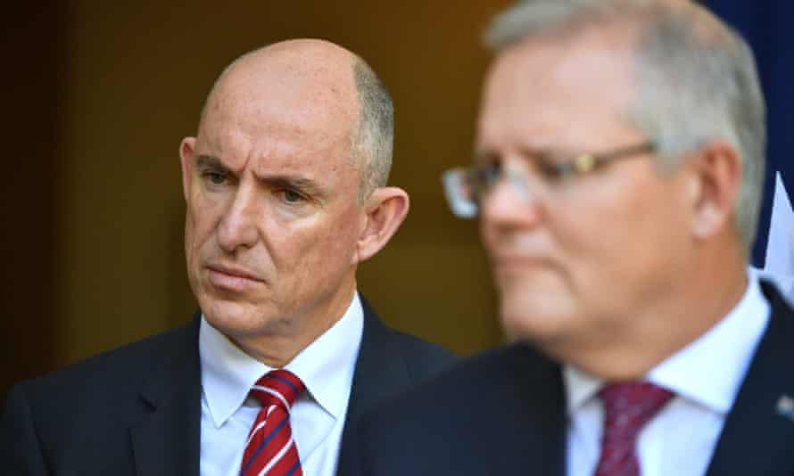 The government services minister, Stuart Robert, pictured with Scott Morrison, said Services Australia would pay 'some 190,000 [people] from 1 July'