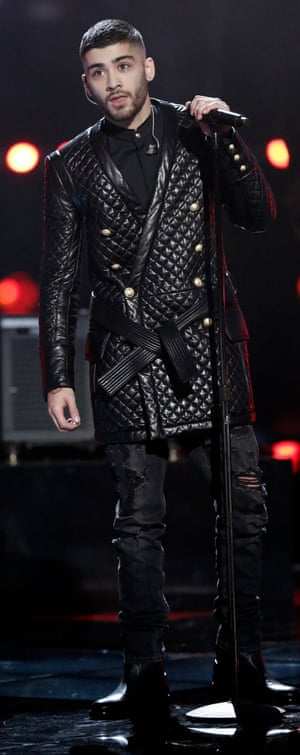 Zayn Malik on The Voice goes for a quilted leather jacket.