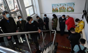 Residents line up to receive vaccines against the Covid-19 coronavirus at a community service centre in Beijing.