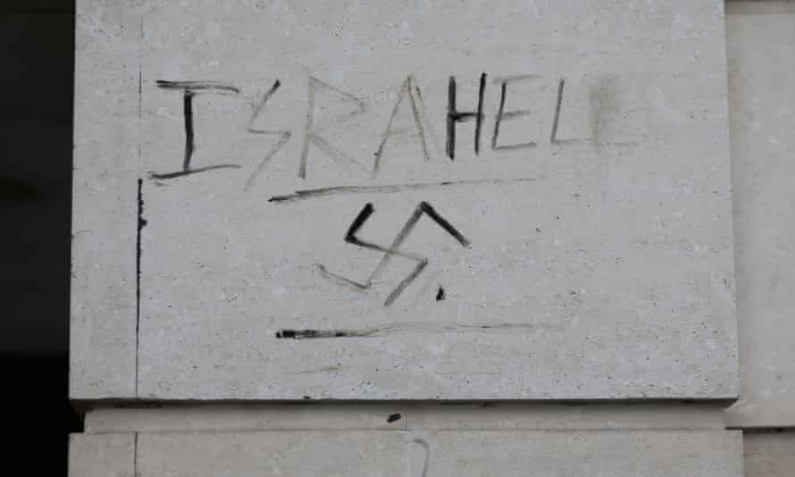 Graffiti next to a swastika on a wall in Victoria, London.