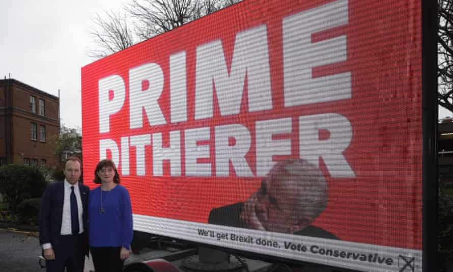 Matt Hancock and Nicky Morgan pose with a campaign poster highlighting what they see as the opposition Labour party leader Jeremy Corbyn's indecision