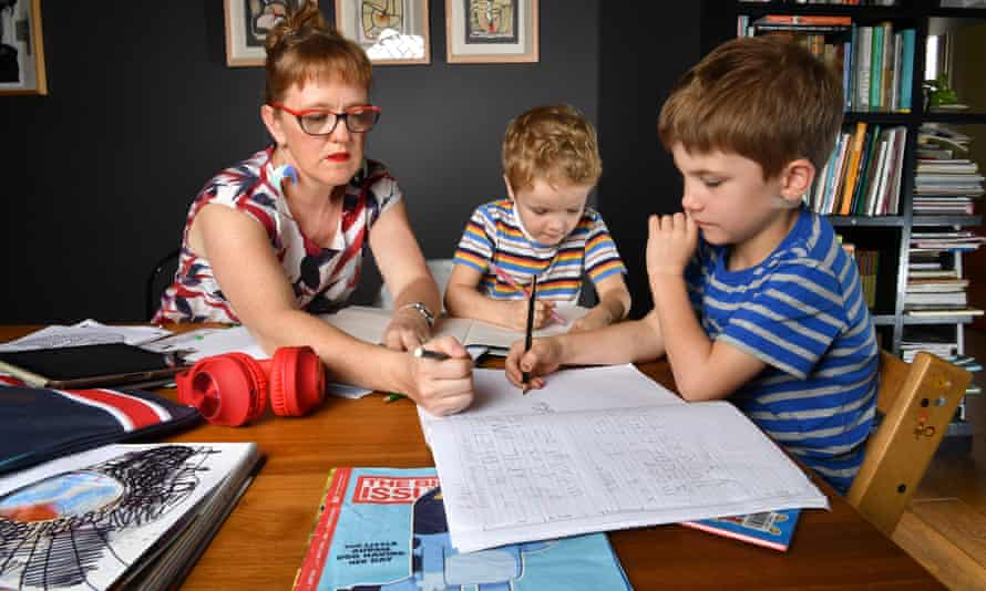 Zoe Collins helps with school work with Dare, age 5, and Douglas, age 7, at their home in Brisbane, in 2020. One academic says a number of different factors impact whether a student struggles during learning from home.
