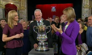Video grab taken from BBC1's Antiques Roadshow of (left to right) BBC Sport's Gabby Logan, Leeds United former manager Eddie Gray and Antiques Roadshow presenter Fiona Bruce, with the longest-serving FA Cup trophy in the competition's history.
