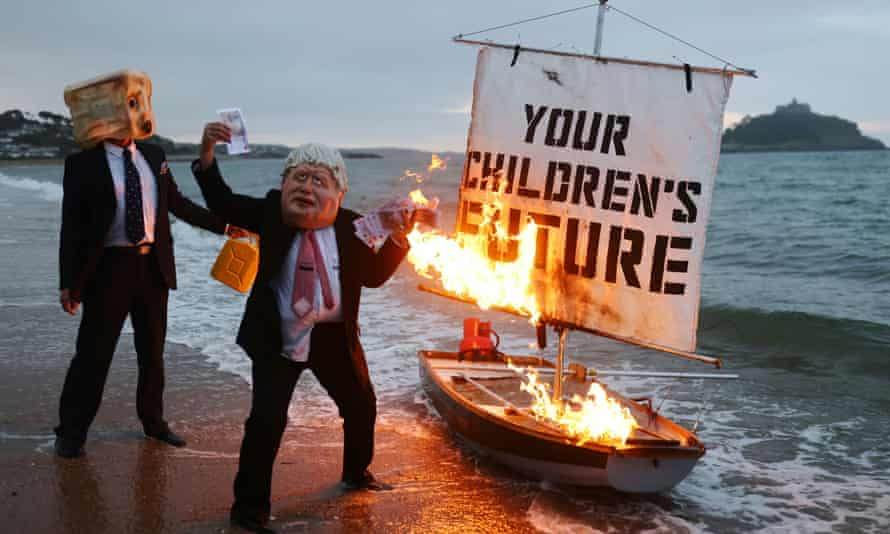 Activists from the climate action group Ocean Rebellion set a boat on fire in Cornwall ahead of the G7 summit in the UK