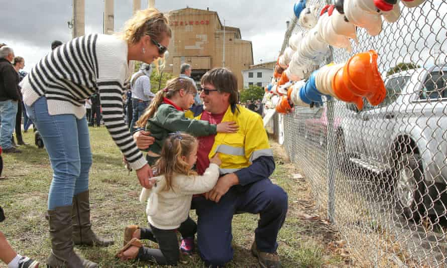 Robb Ortel is embraced by his family after finishing his last shift at Hazelwood power station on Friday.