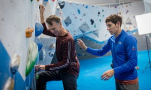 Honnold helps Sam Wollaston with his bouldering.