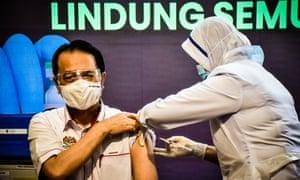 Malaysia Health director-general Tan Sri Dr. Noor Hisham Abdullah undergoing the Covid-19 vaccine process at the Putrajaya Health Office, Malaysia on 24 February, 2021.