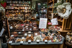 a display of truffles and other sundries in the counter of a chocolate shop in bruges belgium