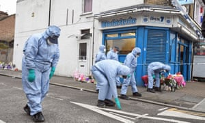 Forensic officers search Chalgrove Road in Tottenham, north London, where a 17-year-old girl was shot on Monday evening