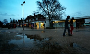 The forlorn shopping precinct in Hatfield town centre on a rainy evening.
