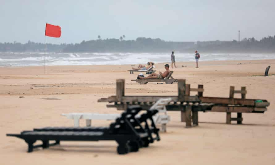 Empty sunbathing chairs are seen on a beach near hotels in a tourist area in Bentota, Sri Lanka