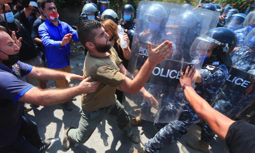Lebanese protesters clash with security forces as they try to storm the Ministry of Energy in Beirut during a demonstration about recurrent power cuts.
