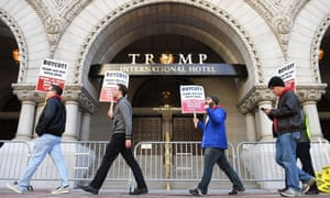Protesters outside the Trump International Hotel. The president gained just 4% of the vote in the district.