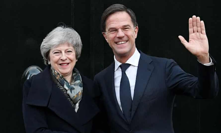 Theresa May is welcomed by Dutch Prime Minister Mark Rutte ahead of a meeting in the Hague, the Netherlands, on 11 December.