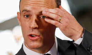 Dominic Raab with a hand to his brow