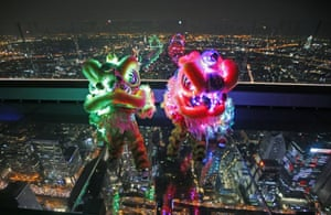 Lion dance with LED lights, perform on the glass deck of the King Power Mahanakhon building, currently Thailand's tallest at 314 meters (1,030 feet) tall, Bangkok, Thailand