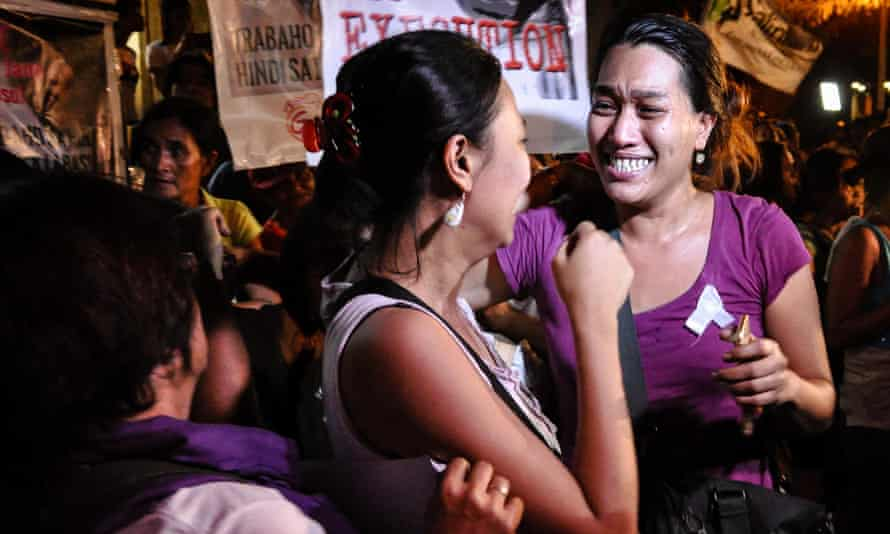 Supporters rejoice after hearing the news of Veloso's stay of execution.
