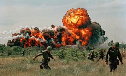 A napalm strike near US troops on patrol in South Vietnam, 1966.