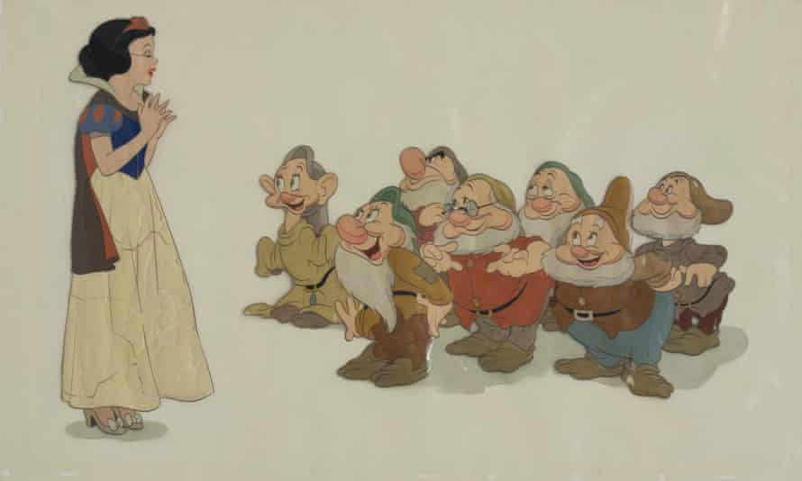 A cel of Snow White singing to the seven dwarfs from Snow White and the Seven Dwarfs exhibiting signs of cellulose plastic deterioration.