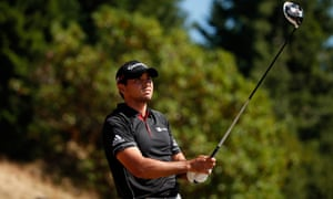 Jason Day of Australia watches his tee shot on the 5th