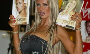 Model Katie Price pouts for cameras with copies of her autobiographer.