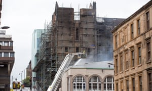 Firefighters attending the scene of the fire at the Glasgow School of Art, Mackintosh building.