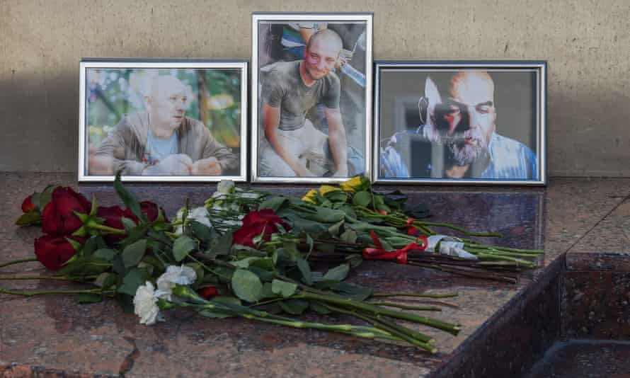 Flowers left in front of photographs of Russian journalists (left to right) Alexander Rastorguyev, Kirill Radchenko and Orkhan Dzhemal, who were recently killed in the Central African Republic, outside the Central House of Journalists in Moscow