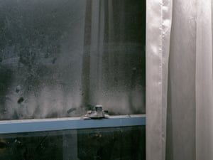 Dust accumulates on the window of a hotel room in Sydney