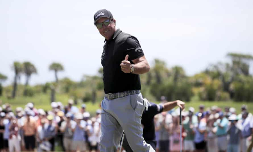 Phil Mickelson is tied for the lead at halfway as he bids to become the oldest major winner in golf history.