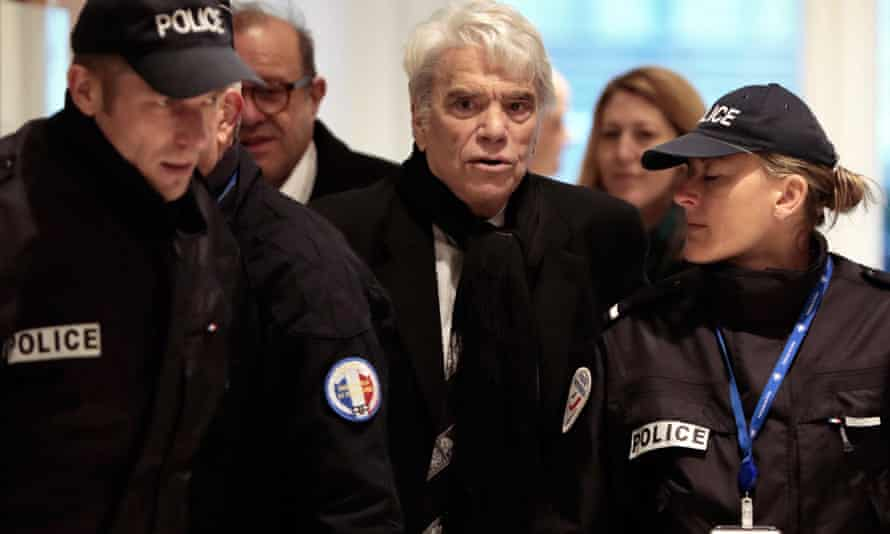 Tapie arrives at a Paris courthouse for his trial in March 2019