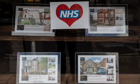 London estate agent's window with NHS poster