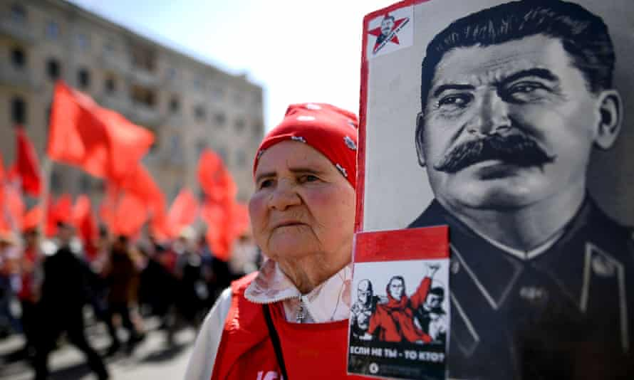 A Communist party activist with a banner of Joseph Stalin at a May Day rally in Moscow.