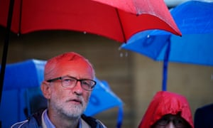 Jeremy Corbyn under an umbrella in the rain on a visit to the Centre for Alternative Technology in Machynlleth, Wales, on 16 August 2019.