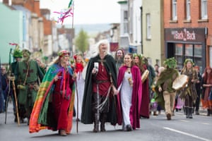 The May Day King and Queen lead the procession