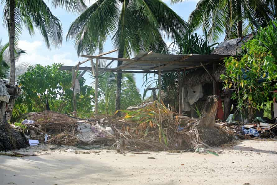 Remnants of storm damage is seen outside the home of Katoatau's parents in Kiribati