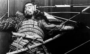 Toshiro Mifune as a feudal lord in Alira Kurosawa's Throne of Blood, is pinned to a castle wall by spears