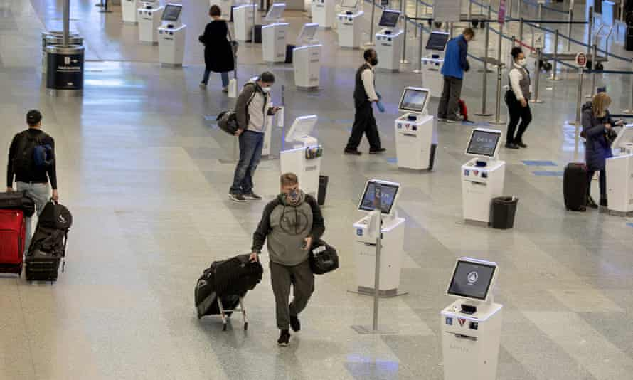 Travelers make their way through the Minneapolis-St. Paul international airport during the coronavirus pandemic.