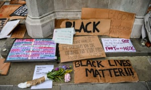 Black Lives Matter signs and placards at the base of the Edward Colston statue plinth in Bristol city centre in June.
