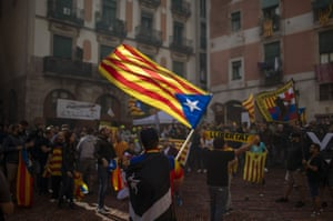 Protesters hold independence flags during Catalan national day.