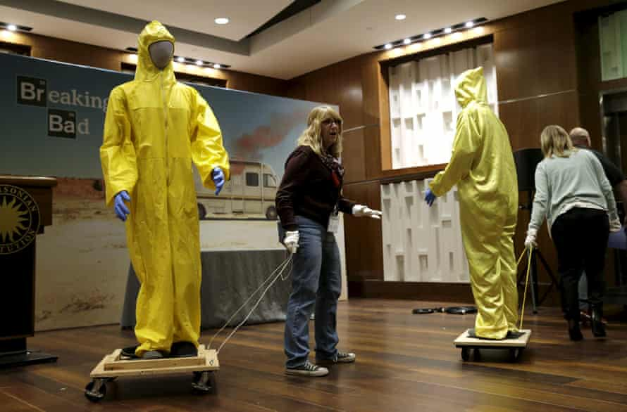 Yellow Tyvek suits are taken away after the memorabilia donation.