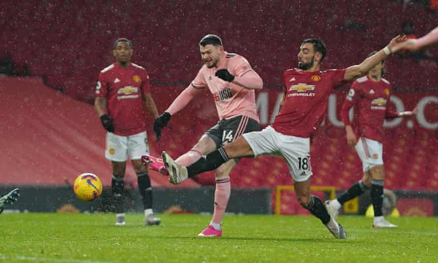 Sheffield United's Oliver Burke shoots before a heavy deflection brings about his side's winning goal.