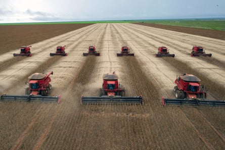 Combine harvesters crop soybeans in Campo Novo do Parecis, a former rainforest in Mato Grosso, Brazil.